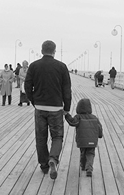 Father and son at pier