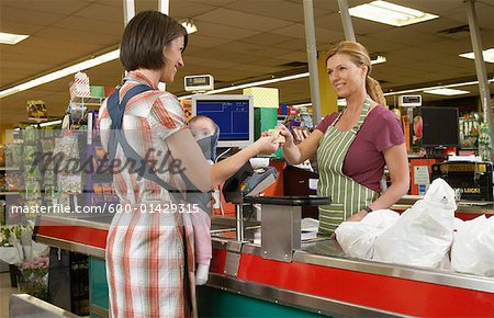 Mother with Baby at Cashier in Grocery Store Stock Photo - Premium Royalty-Free, Artist: Masterfile, Code: 600-01429315