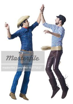 Man in cowboy costume and man in leather pants with waist sash ...