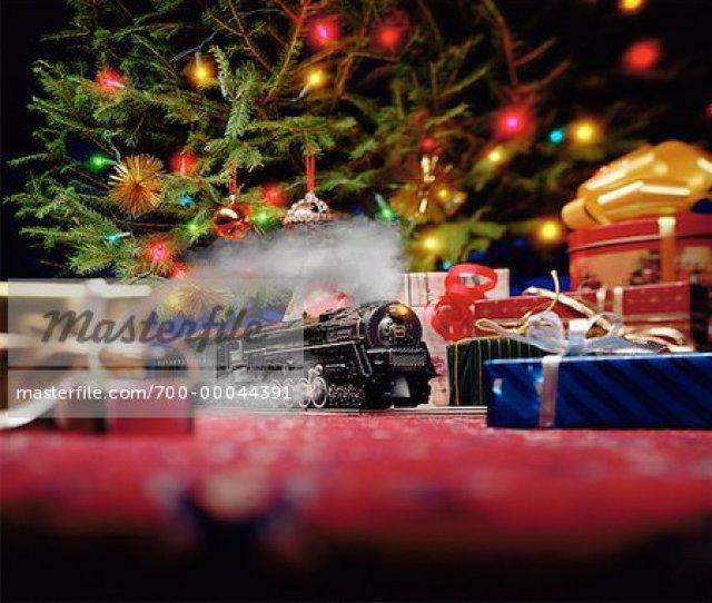 Toy Train Set Under Christmas Tree Stock Photo