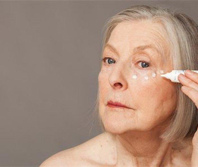 Senior Woman Applying Eye Cream Stock Photo Premium Royalty Free Code