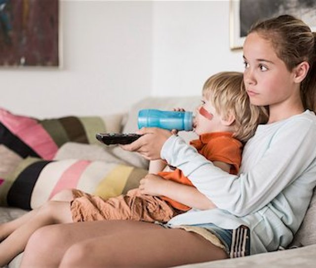 Brother And Sister Watching Tv At Home Stock Photo Premium Royalty Free Code
