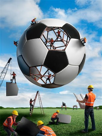 Construction Workers Building a Soccer Ball Stock Photo - Rights-Managed, Code: 700-02264970