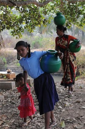 Indian women carrying water Stock Photos - Page 1 : Masterfile