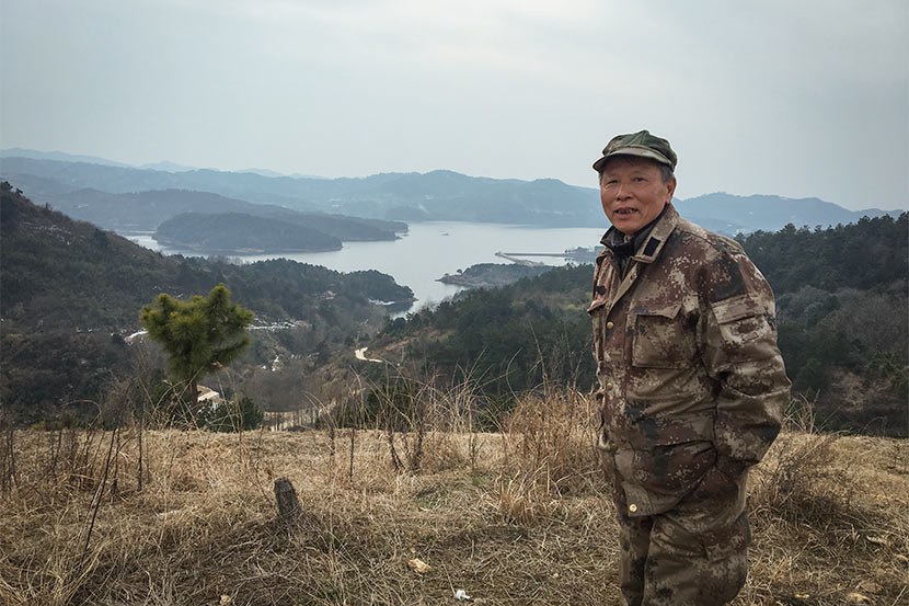 Shen Exiang poses for a photo on the Hanzi Mountain on the outskirts of Wuhan, Hubei province, Feb. 7, 2018. Fan Yiying/Sixth Tone