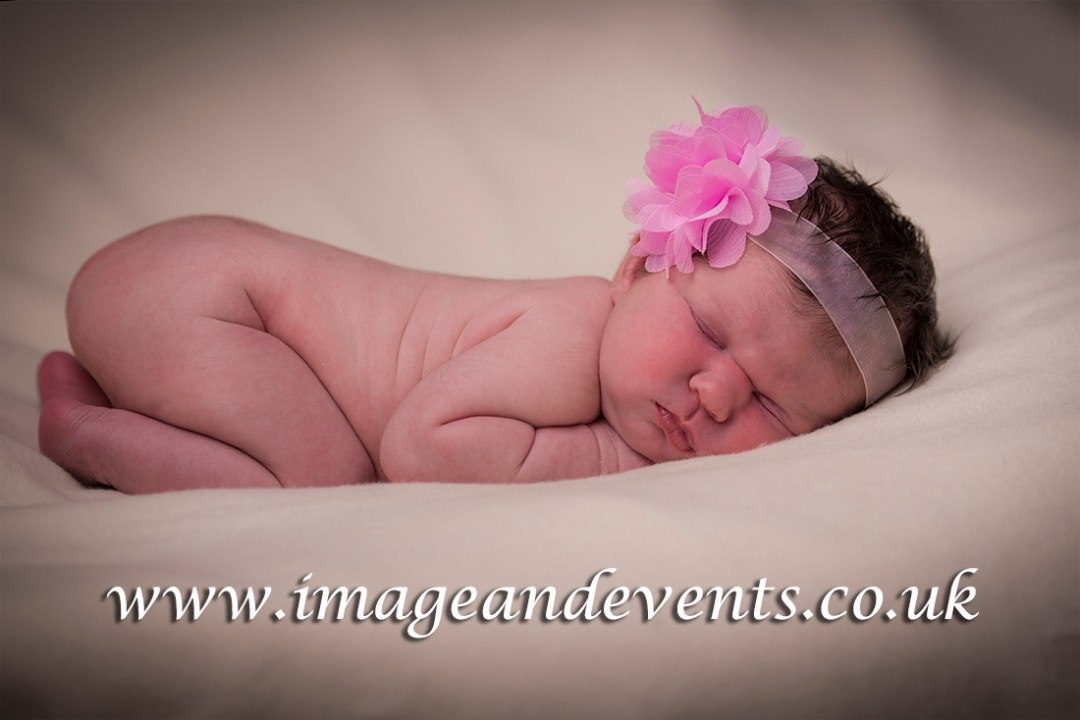 Full length newborn photograph from Peterborough Studio