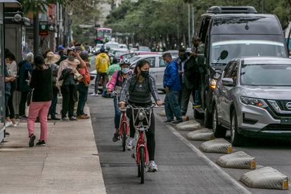 People ride bicycles in the Centro Histórico neighborhood of Mexico City.