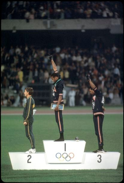 Tommy Smith and John Carlos raise their fists in solidarity with the Black Power in Mexico 1968.