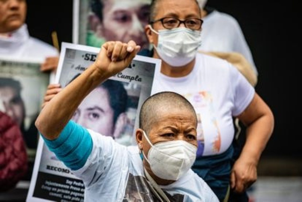 A woman protests the application of the amnesty to people imprisoned in the State of Mexico, outside the state representation in Mexico City, on July 1, 2021.