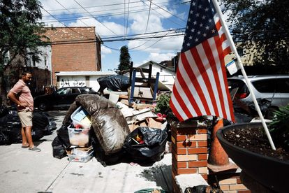 A person sorts belongings from his flooded home in a Queens, New York neighborhood that suffered massive flooding and numerous deaths after a night of high winds and rain from the remnants of Hurricane Ida on September 3, 2021.