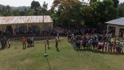 The lines during the food delivery in the rural mountain school.