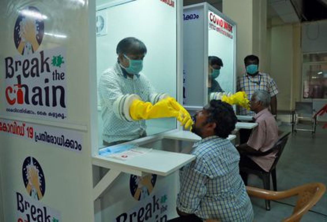 Medical staff from a medical school collect swabs from people for testing for coronavirus disease (COVID-19) at a walk-in sampling kiosk in Ernakulam, Kerala, India on April 6, 2020.