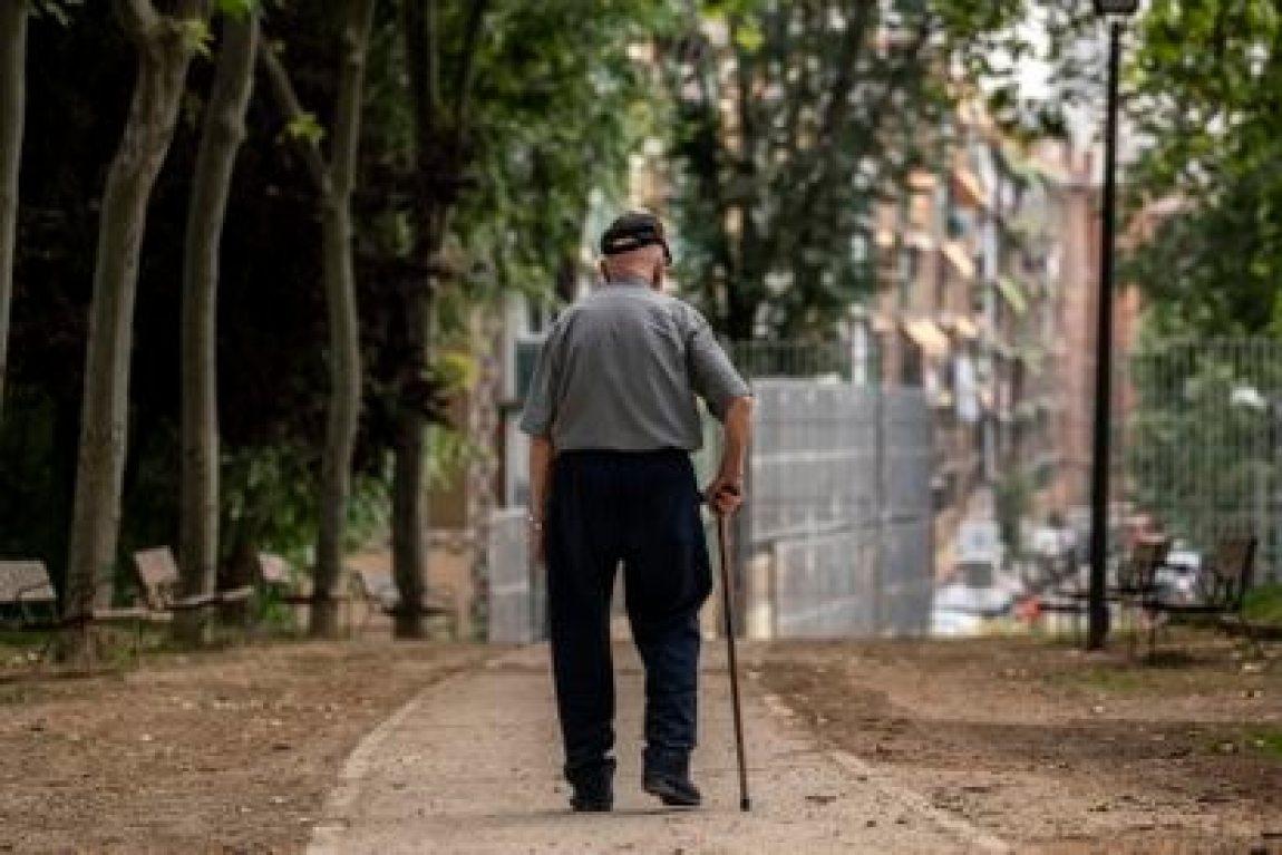 A man walks last Friday through a park in Madrid.