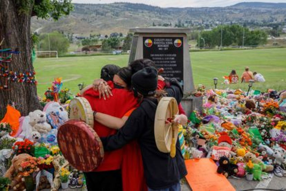 Relatives of internees in Mosakahiken, in front of a memorial for the victims on June 4, 2021.
