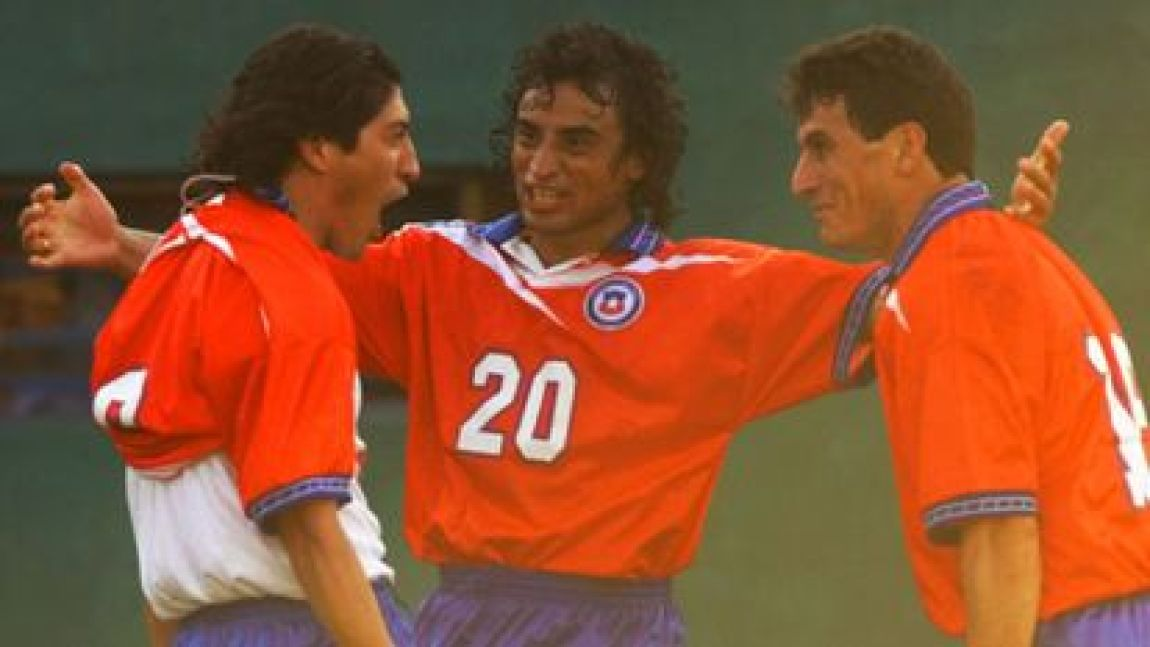 Iván Zamorano celebrates with Fabián Estay and Pedro Gonzalez, at the 1999 Copa América, in Luque, Paraguay.