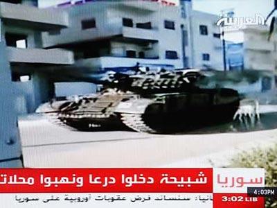 Imagen de la cadena Al Arabiya, que muestra a un tanque en Deraa.-