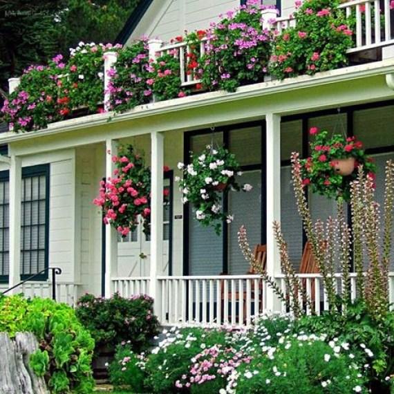 Casas bonitas con jardin lleno de flores
