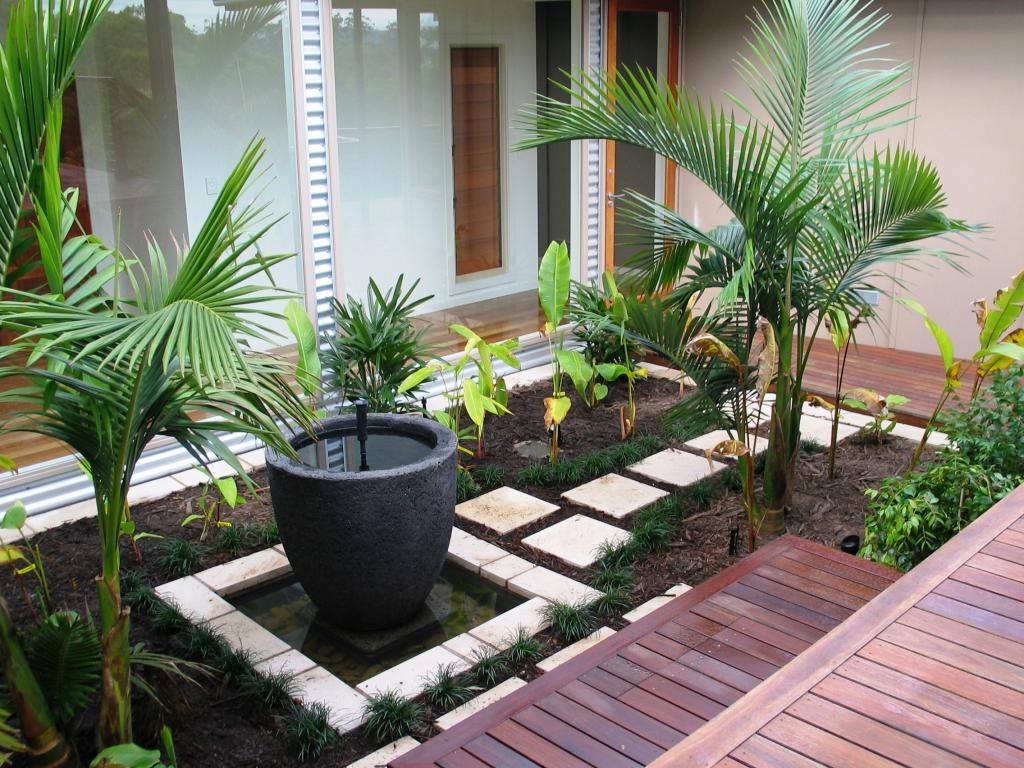 Jardines modernos minimalistas con piedras for Small simple garden design ideas