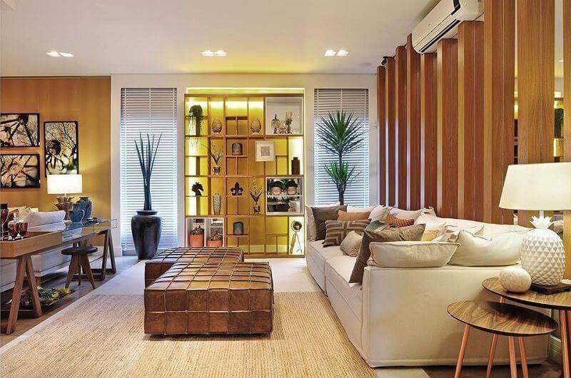 sala planejada com estante vazada projeto de quitete e faria