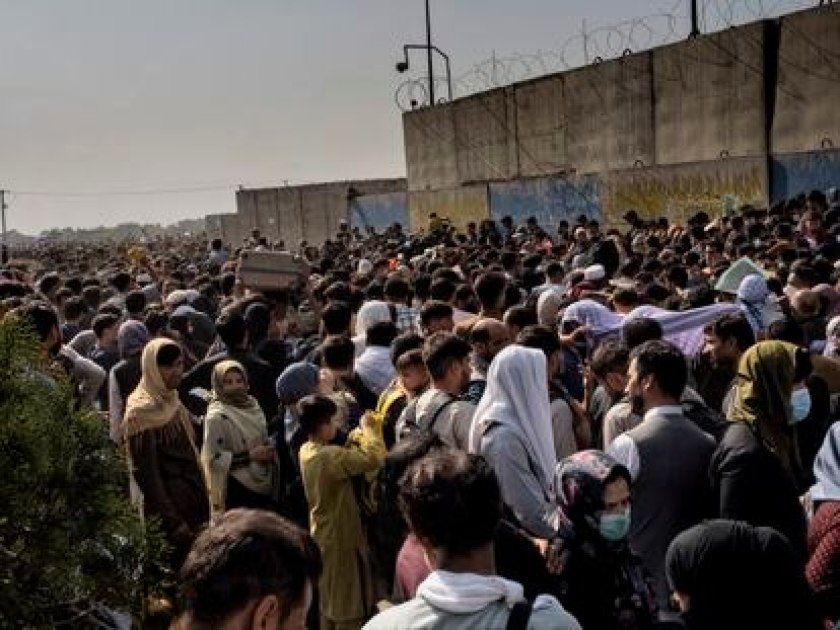 Thousands of Afghans wait outside Kabul airport.