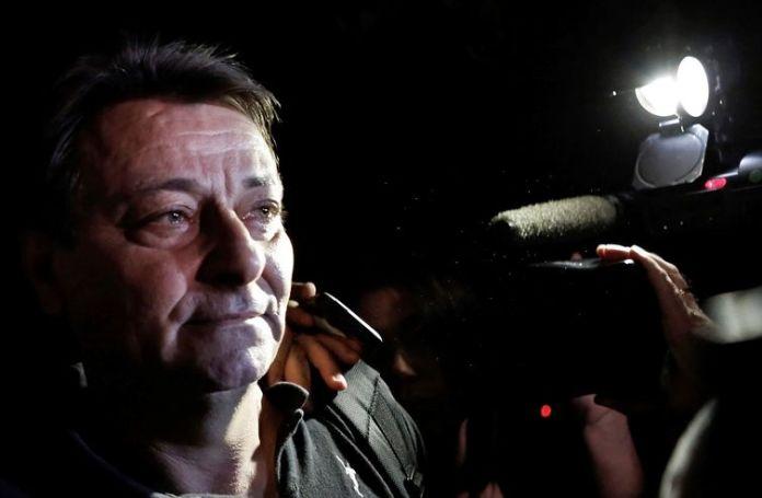 FILE PHOTO: Italian former leftist guerrilla Cesare Battisti leaves the headquarters of the Federal Police in Sao Paulo March 13, 2015. REUTERS/Nacho Doce/File Photo