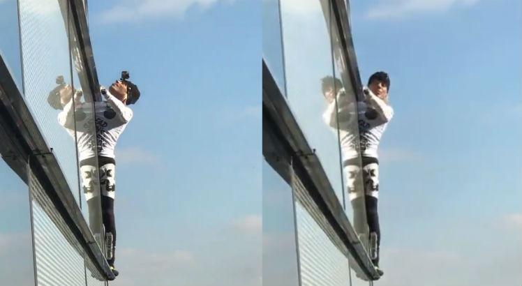 ha4 748 - Homem escala prédio de 230 metros usando apenas a força do corpo