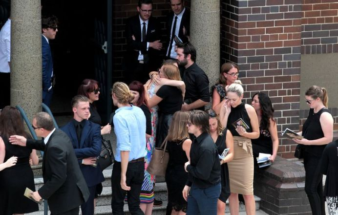 Mourners congregate ahead of the funeral outside St Mary's Catholic Church in Concord. (AAP)