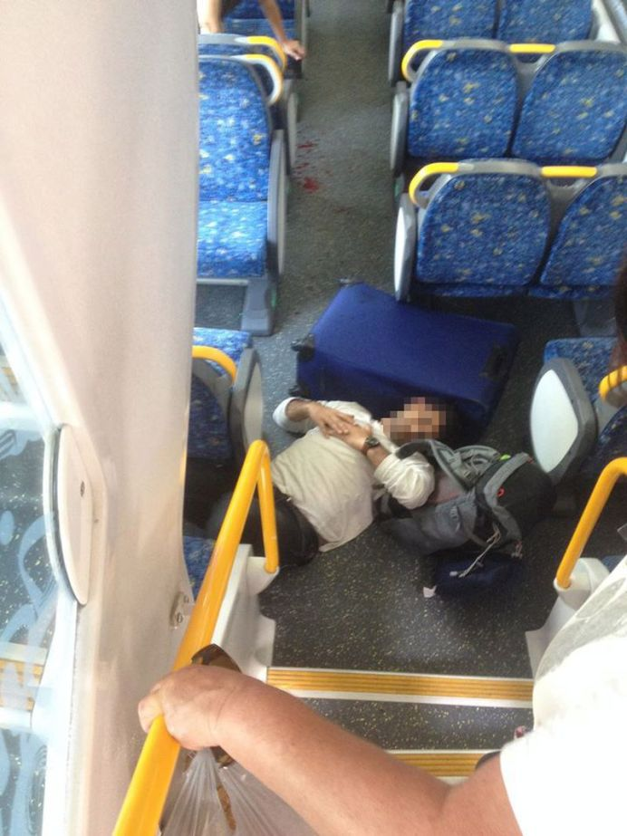 One passenger was seen lying at the bottom of a set of stairs after falling in the collision (Supplied).