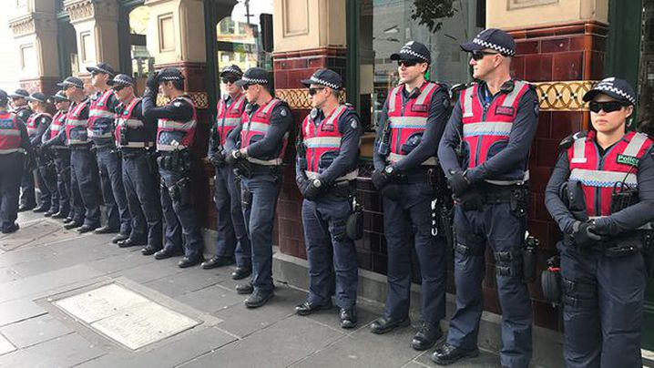 A large number of response police officers are waiting around the corner from the site. (9NEWS/Sean Davidson)