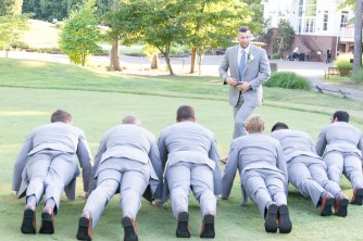 A groom has his groomsmen do pushups during a wedding at Westfields Golf Club in Clifton, Virginia. Wedding photography by Erin Julius of Imagery by Erin.