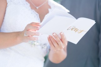 A bride reads a note from her fiance during a wedding at The Citadel in Charleston, SC.