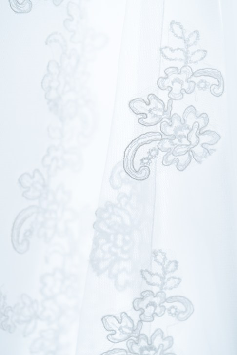 A closeup shot of the lace on a bride's dress during a wedding at The Citadel in Charleston, SC