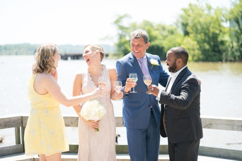 A bride and groom toast following their elopement in Old Town Alexandria.
