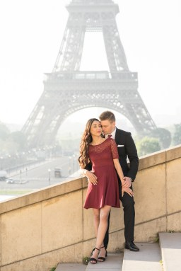 A couple in front of the Eiffel Tower during their engagement session in Paris.