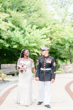 A couple walks hand-in-hand following a National Museum of the Marine Corps wedding.