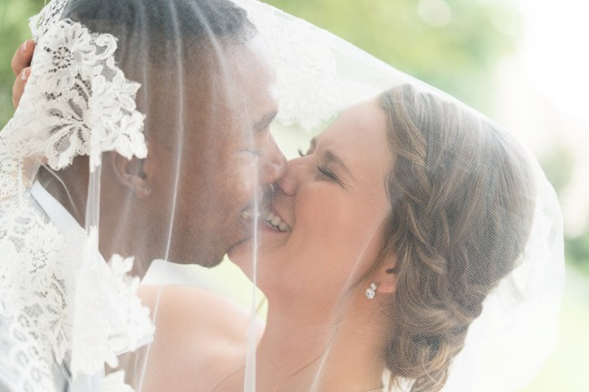 A bride and groom kiss on their wedding day