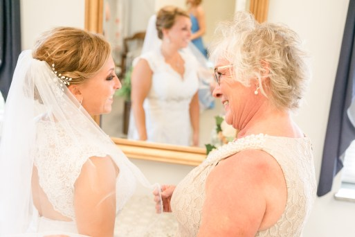 Bride her mother during wedding at the Citadel in Charleston SC. Charleston wedding photography by Imagery by Erin