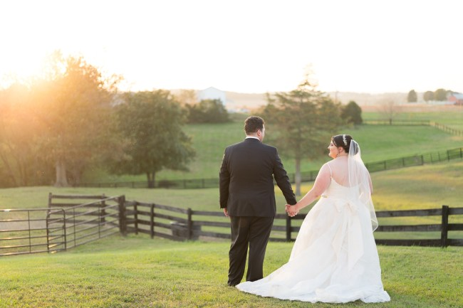 A bride and groom pose at sunset during their wedding at Hermitage Hill Farm.