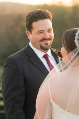 A groom looks at his bride at sunset on their wedding day at Hermitage Hill Farm in Waynesboro, Virginia.