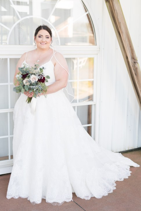 A bride poses in her Allure Bridals dress before her wedding at Hermitage Hill Farm in Waynesboro, Virginia.
