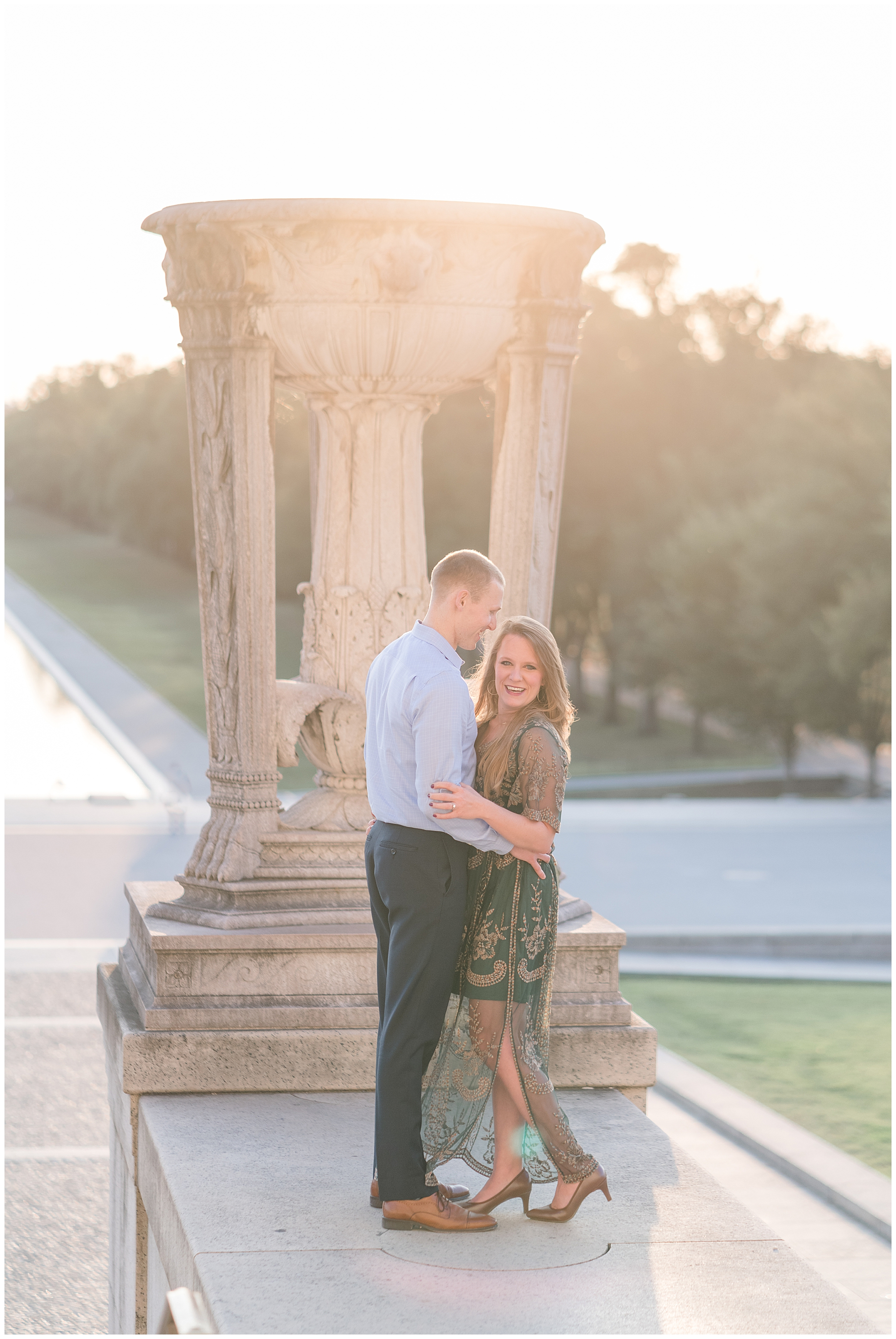 A couple hugs during their DC engagement session at the Lincoln Memorial.