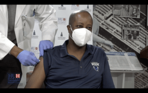 Dr. Wayne A.I. Frederick, president of Howard University, receives a COVID-19 vaccine