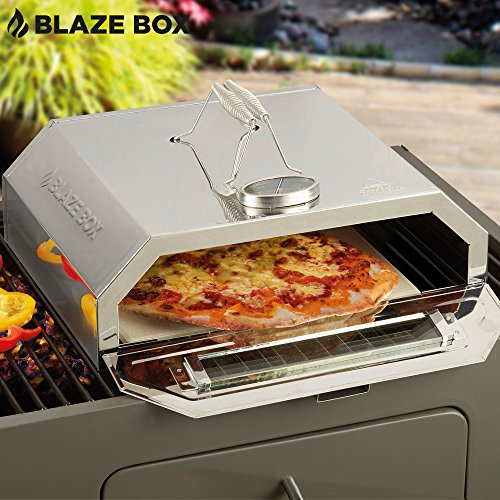 Blaze Box BBQ Pizza Oven with Temperature Gauge for Outdoor Garden Barbecues & Gas Grills (Pizza Oven)- The Blaze Box BBQ Pizza Oven can be purchased at a fair price for those who need a reliable mini pizza oven. The small unit weighs about 3.54kg and measures 37.5 x 29 x 13 cm. How it works is that you have to have a hob or a BBQ grill that is already lit. Place the mini pizza oven on top of the BBQ grill and wait for it to heat up before inserting the uncooked pizza.