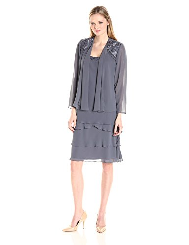 Sleeveless chiffon dress with embellished scoop neckline and tiered skirt Includes matching jacket with embellished shoulders and flyaway front