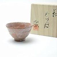 Japanese traditional ceramic Hagi ware.Hagi ido guinomi sake cup made by Kiyoshi Yamato.