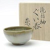 Hagi yaki Japanese ceramic. Flowing white guinomi sake cup with wooden box made by Takao Tahara.