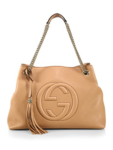"""41SiCrdAATL Gucci Camelia Soho Med Shoulder Bag Leather Soft Classic Handbag Italy New Leather Natural cotton linen lining, tassel. Medium size: 15""""W X 10.6""""H X 5.5""""D Embossed interlocking G Detachable leather tassel Double chain shoulder straps with leather shoulder pad, 8.75 """" drop shoulder handles. Inside hook closure Founded in Florence in 1921, Gucci is one of the world's leading luxury fashion brands, with a renowned reputation for creativity, innovation and Italian craftsmanship. Gucci is part of the Kering Group, a world leader in apparel and accessories that owns a portfolio of powerful luxury and sport and lifestyle brands."""