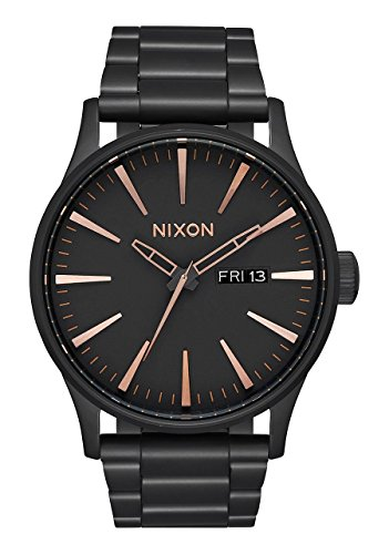3-hand movement, day/date window at 3 o'clock and printed seconds track A timeless 42 mm design with the modern Nixon twist of faceted applied hour indices Japanese-quartz Movement