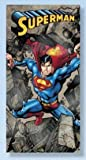 Superman Crashing Through Rocks Beach / Bath Towel