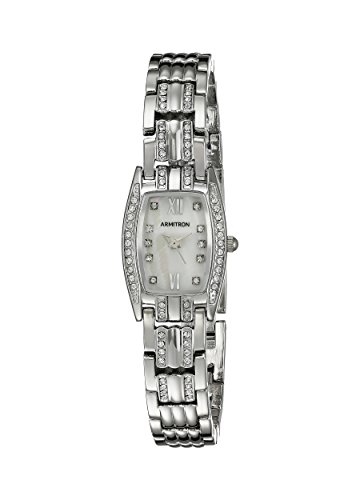 41cjlXf10cL Organic shaped case; bezel and lugs set with 30 clear Swarovski crystals; mother-of-pearl dial with silver-tone hands and 10 clear Swarovski crystal markers Silver-tone adjustable link bracelet with 32 clear Swarovski crystals; jewelry clasp and extender Quartz Movement